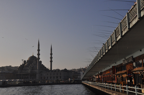New Mosque and Bridge With Fishing Poles