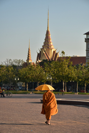 Buddhist Monk with Yellow Umbrella Walking to Cambodian Supreme Court
