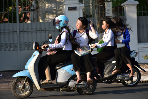 Schoolgirls on Scooters