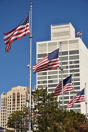 American Flags and White Building 1