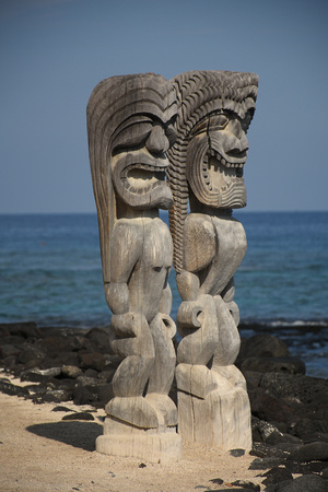 Two Statues with Scary Expressions by the Sea