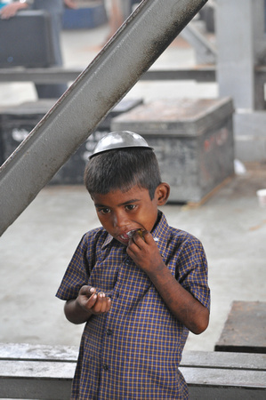 Beggar Boy Eating Candy